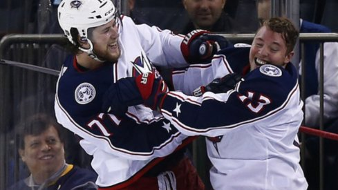 Columbus Blue Jacket forwards Cam Atkinson and Josh Anderson celebrate after defeating the New York Rangers in April of 2019 at Madison Square Garden to clinch a playoff berth.