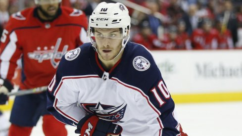 Columbus Blue Jackets forward Alexander Wennberg controls the puck during a regular-season matchup against the Washington Capitals in February of 2018 at Capital One Arena.