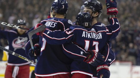 Seth Jones and Cam Atkinson celebrate a Blue Jackets goal scored against the Pittsburgh Penguins at Nationwide Arena.