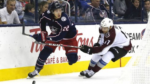 Oct 9, 2018; Columbus, OH, USA; Columbus Blue Jackets left wing Sonny Milano (22) looks to pass as Colorado Avalanche center Tyson Jost (17) defends during the first period at Nationwide Arena.
