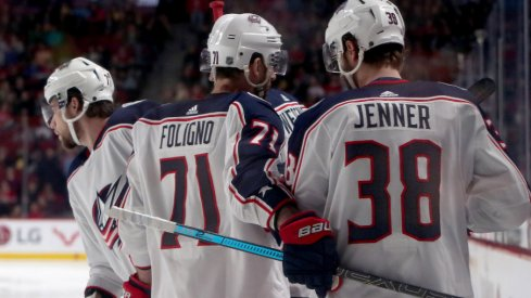 Columbus Blue Jackets forwards Nick Foligno, Boone Jenner and Josh Anderson celebrate a goal against the Montreal Canadiens at the Bell Centre in February of 2019.