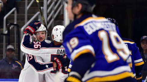 Sep 22, 2019; St. Louis, MO, USA; Columbus Blue Jackets left wing Jacob Lilja (15) is congratulated by center Marko Dano (56) after scoring during the first period against the St. Louis Blues at Enterprise Center.