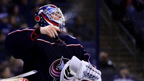 Columbus Blue Jackets goaltender Joonas Korpisalo (70) spits water from his Gatorade bottle during a stop in play against the Tampa Bay Lightning at Nationwide Arena.