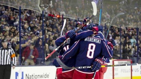 The Columbus Blue Jackets celebrate a goal scored by Zach Werenski against the Ottawa Senators at Nationwide Arena.