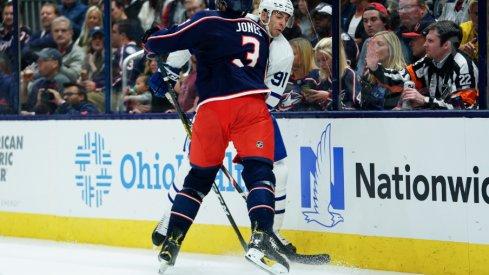 Columbus Blue Jackets defenseman skates toward John Tavares of the Toronto Maple Leafs during his team's home opener at Nationwide Arena.