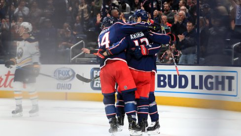 Columbus Blue Jackets right wing Cam Atkinson (13) celebrates with teammates after scoring a goal on a power play against the Buffalo Sabres in the first period at Nationwide Arena