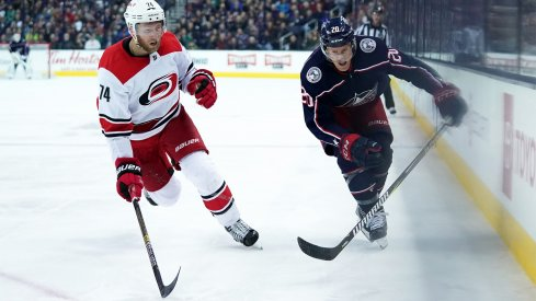 Mar 15, 2019; Columbus, OH, USA; Carolina Hurricanes defenseman Jaccob Slavin (74) skates against Columbus Blue Jackets center Riley Nash (20) in the second period at Nationwide Arena.