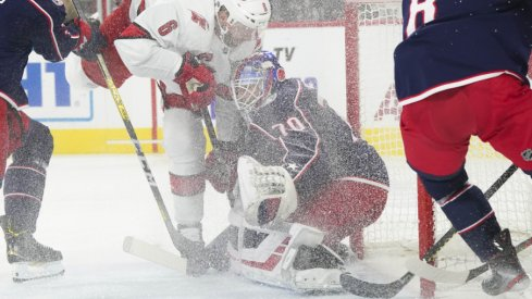 Columbus Blue Jackets goaltender Joonas Korpisalo is pictured attempting to make a save during a regular-season matchup against the Carolina Hurricanes at PNC Arena during October of 2019.