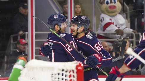 Markus Nutivaara and Ryan Murray celebrate a goal