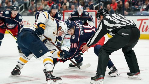 Oct 7, 2019; Columbus, OH, USA; Buffalo Sabres center Casey Mittelstadt (37) battles against Columbus Blue Jackets center Alexander Wennberg (10) for the face-off in the second period at Nationwide Arena.