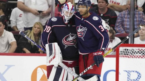 Joonas Korpisalo and Seth Jones celebrate after a 3-2 win over the Carolina Hurricanes on Saturday night.