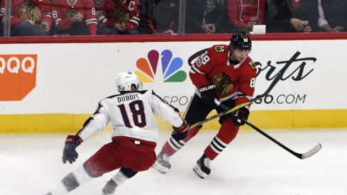 Chicago Blackhawks right wing Patrick Kane (88) is defended by Columbus Blue Jackets center Pierre-Luc Dubois (18) during the first period at United Center.