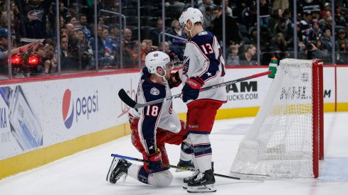 Columbus Blue Jackets center Pierre-Luc Dubois (18) celebrates with right wing Cam Atkinson (13) after scoring an empty net goal in the third period against the Colorado Avalanche at the Pepsi Center.