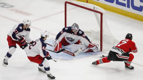Oct 18, 2019; Chicago, IL, USA; Chicago Blackhawks center Dylan Strome (17) tries to score against Columbus Blue Jackets goaltender Elvis Merzlikins (90) during the second period at United Center.