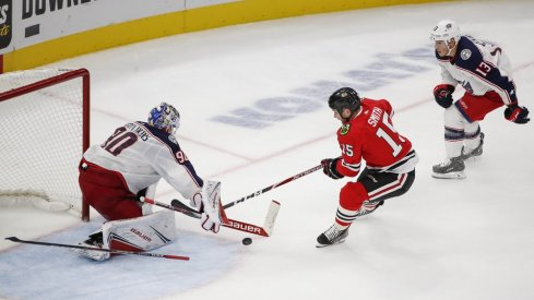 Oct 18, 2019; Chicago, IL, USA; Chicago Blackhawks center Zack Smith (15) tries to score against Columbus Blue Jackets goaltender Elvis Merzlikins (90) during third period at United Center. Mandatory Credit: Kamil Krzaczynski-USA TODAY Sports