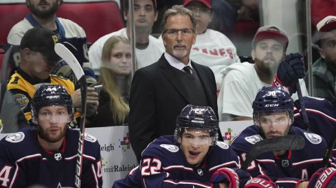 Oct 12, 2019; Raleigh, NC, USA; Carolina Hurricanes head coach John Tortorella looks on from behind the p[layers bench against the Carolina Hurricanes at PNC Arena. The Columbus Blue Jackets defeated the Carolina Hurricanes 3-2.
