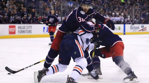 Mar 2, 2019; Columbus, OH, USA; Columbus Blue Jackets center Boone Jenner (38) is called for a holding penally against Edmonton Oilers center Connor McDavid (97) in the third at Nationwide Arena.