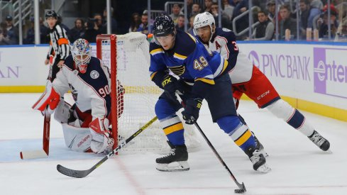 Nov 1, 2019; St. Louis, MO, USA; St. Louis Blues center Ivan Barbashev (49) skates with the puck as Columbus Blue Jackets defenseman Seth Jones (3) and goaltender Elvis Merzlikins (90) defend the net during the second period at Enterprise Center.