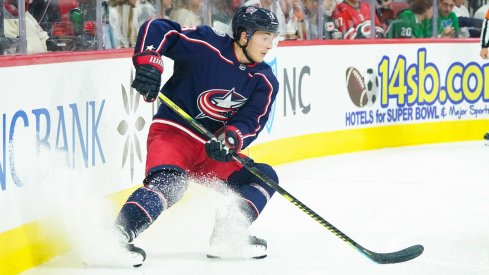 Oct 12, 2019; Raleigh, NC, USA; Columbus Blue Jackets defenseman Zach Werenski (8) stops with the puck against the Carolina Hurricanes at PNC Arena. The Columbus Blue Jackets defeated the Carolina Hurricanes 3-2. Mandatory Credit: James Guillory-USA TODAY Sports
