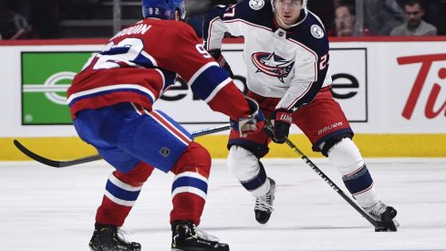 Columbus Blue Jackets defenseman Ryan Murray (27) plays the puck and Montreal Canadiens forward Jonathan Drouin (92) defends during the second period at the Bell Centre.