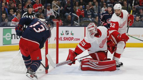 Nov 21, 2019; Columbus, OH, USA; Columbus Blue Jackets right wing Cam Atkinson (13) scores a goal against Detroit Red Wings goalie Jimmy Howard (35) during the second period at Nationwide Arena. Mandatory Credit: Russell LaBounty-USA TODAY Sports