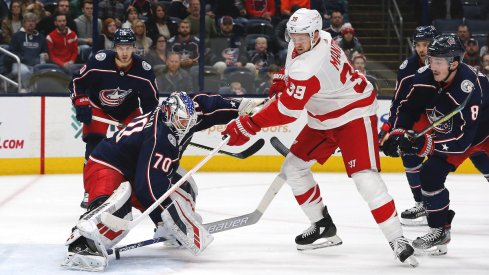 Columbus Blue Jackets goalie Joonas Korpisalo (70) makes a stick save against the Detroit Red Wings during the first period at Nationwide Arena.