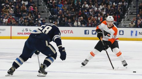 Nov 27, 2019; Columbus, OH, USA; Philadelphia Flyers center Morgan Frost (48) passes the puck against the Columbus Blue Jackets during the first period at Nationwide Arena.