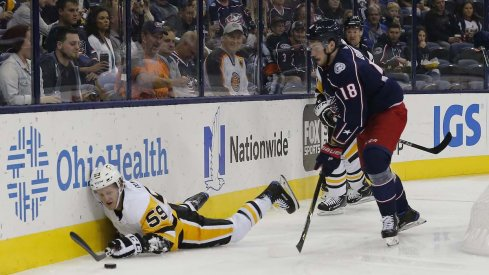 Columbus Blue Jackets center Pierre-Luc Dubois chases the puck behind the net in a game against the Pittsburgh Penguins at Nationwide Arena.