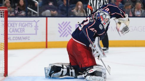 Columbus Blue Jackets goaltender Joonas Korpisalo (70) makes a glove save in net against the St. Louis Blues in the third period at Nationwide Arena.