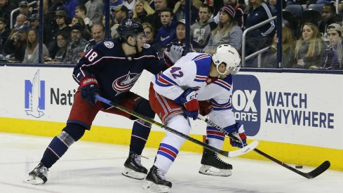 Jan 13, 2019; Columbus, OH, USA; Columbus Blue Jackets left wing Pierre-Luc Dubois (18) and New York Rangers defenseman Brendan Smith (42) battle the puck during the second period at Nationwide Arena. Mandatory Credit: Russell LaBounty-USA TODAY Sports