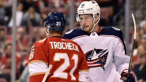 Oct 11, 2018; Sunrise, FL, USA; Columbus Blue Jackets center Pierre-Luc Dubois (18) exchange words with Florida Panthers center Vincent Trocheck (21) during the first period at BB&T Center.