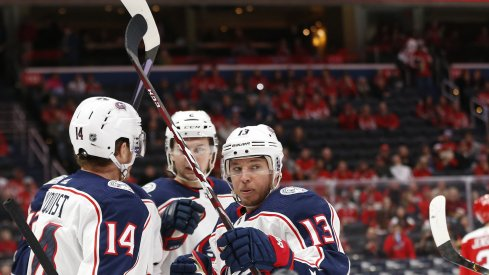 Dec 9, 2019; Washington, DC, USA; Columbus Blue Jackets right wing Cam Atkinson (13) celebrates with teammates after scoring a goal against the Washington Capitals in the first period at Capital One Arena. Mandatory Credit: Geoff Burke-USA TODAY Sports