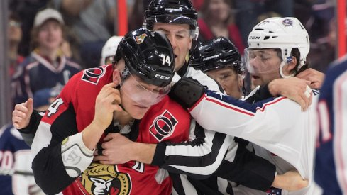 Ottawa Senators defenseman Mark Borowiecki (74) fights with Columbus Blue Jacketsv right wing Josh Anderson (77) in the first period at the Canadian Tire Centre.