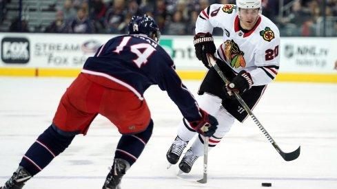 Chicago Blackhawks left wing Brandon Saad (20) skates against Columbus Blue Jackets defenseman Dean Kukan (14) in the third period at Nationwide Arena.