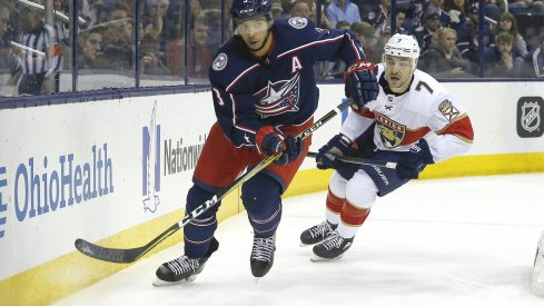 Mar 22, 2018; Columbus, OH, USA; Columbus Blue Jackets defenseman Seth Jones (3) and Florida Panthers center Colton Sceviour (7) chase after a loose puck during the third period at Nationwide Arena.