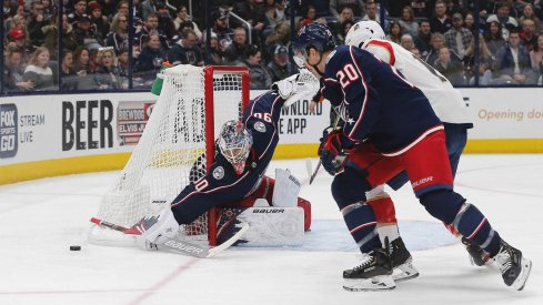 Dec 31, 2019; Columbus, Ohio, USA; Columbus Blue Jackets goalie Elvis Merzlikins (90) makes a sticks save against the Florida Panthers during the first period at Nationwide Arena.