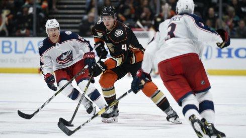 Nov 4, 2018; Anaheim, CA, USA; Anaheim Ducks defenseman Cam Fowler (4) handles the puck during the third period against the Columbus Blue Jackets at Honda Center. Mandatory Credit: Kelvin Kuo-USA TODAY Sports