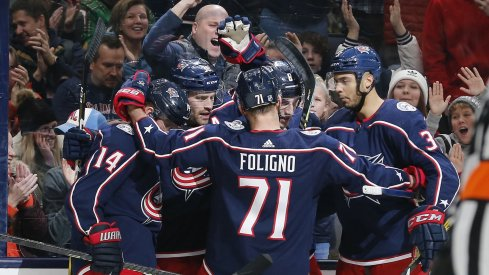 Gustav Nyquist, Boone Jenner, Nick Foligno, Zach Werenski and Seth Jones celebrate a goal for the Columbus Blue Jackets against the San Jose Sharks on Jan. 4 at Nationwide Arena.