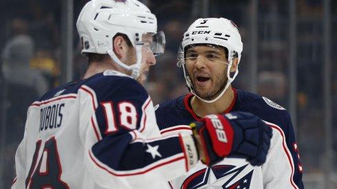 Pierre-Luc Dubois and Seth Jones celebrate an overtime-winning goal against the Boston Bruins.