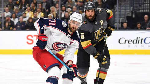 Feb 9, 2019; Las Vegas, NV, USA; Vegas Golden Knights defenseman Deryk Engelland (5) covers Columbus Blue Jackets left wing Nick Foligno (71) during the third period at T-Mobile Arena.