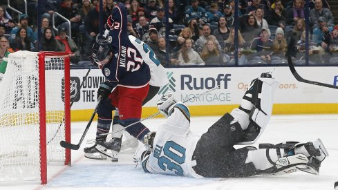 Columbus Blue Jackets left wing Sonny Milano (22) reaches for the rebound against San Jose Sharks goalie Aaron Dell (30) during the second period at Nationwide Arena.