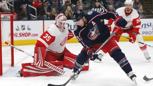 Nov 21, 2019; Columbus, OH, USA; Columbus Blue Jackets right wing Cam Atkinson (13) backhands the puck on net against the Detroit Red Wings during the second period at Nationwide Arena.