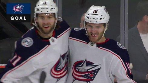 Stenlund and Wennberg celebrate a goal