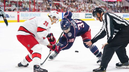 Oct 12, 2019; Raleigh, NC, USA; Carolina Hurricanes right wing Sebastian Aho (20) takes a face off against Columbus Blue Jackets center Boone Jenner (38) at PNC Arena. The Columbus Blue Jackets defeated the Carolina Hurricanes 3-2. Mandatory Credit: James Guillory-USA TODAY Sports