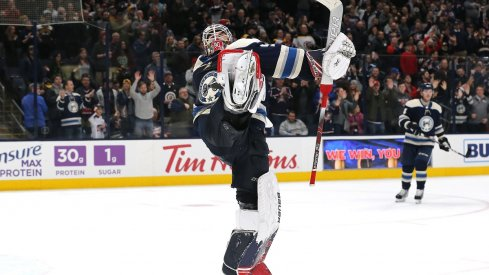 Elvis Merzlikins celebrates his first career home shutout at Nationwide Arena