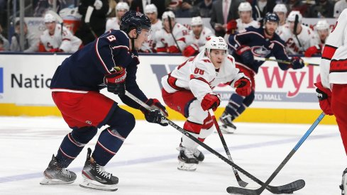 Columbus Blue Jackets defenseman Zach Werenski (8) carries the puck against Carolina Hurricanes right wing Martin Necas (88) during the first period at Nationwide Arena.