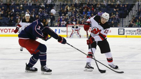 Columbus, OH, USA; Columbus Blue Jackets defenseman Seth Jones (3) defends against New Jersey Devils center Nico Hischier (13) during the third period at Nationwide Arena.