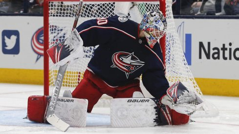 Jan 16, 2020; Columbus, Ohio, USA; Columbus Blue Jackets goalie Elvis Merzlikins (90) makes a glove save against the Carolina Hurricanes during the second period at Nationwide Arena.