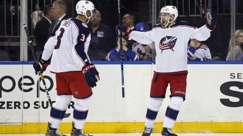 Jan 19, 2020; New York, New York, USA; Columbus Blue Jackets right wing Oliver Bjorkstrand (28) celebrates with teammates after scoring the game winning goal during the third period against the New York Rangers at Madison Square Garden.