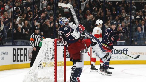 Columbus Blue Jackets goalie Elvis Merzlikins (90) celebrates his first NHL win against the Florida Panthers after the game at Nationwide Arena.